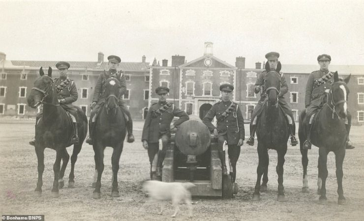 Soldiers on horseback pose for the camera as a dog walks by in one of a series of fascinating photographs from the 1920s