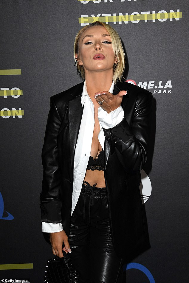 Sweet: While working on the red carpet, Courtney was caught blowing a kiss at photographers