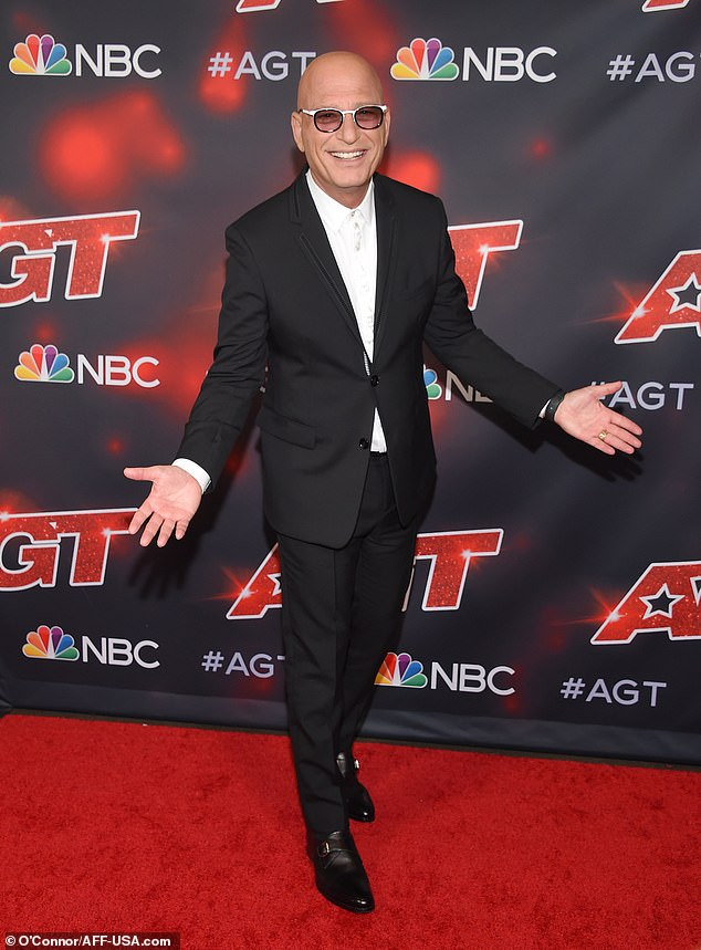 Nailed it:Howie Mandell dominated in the fashion department by arriving in another expertly tailored suit