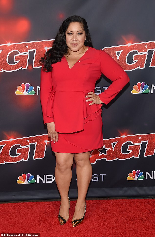 Serve:Gina Brillon highlighted her enviable curves in a bright red peplum dress with a V-neckline and long sleeves