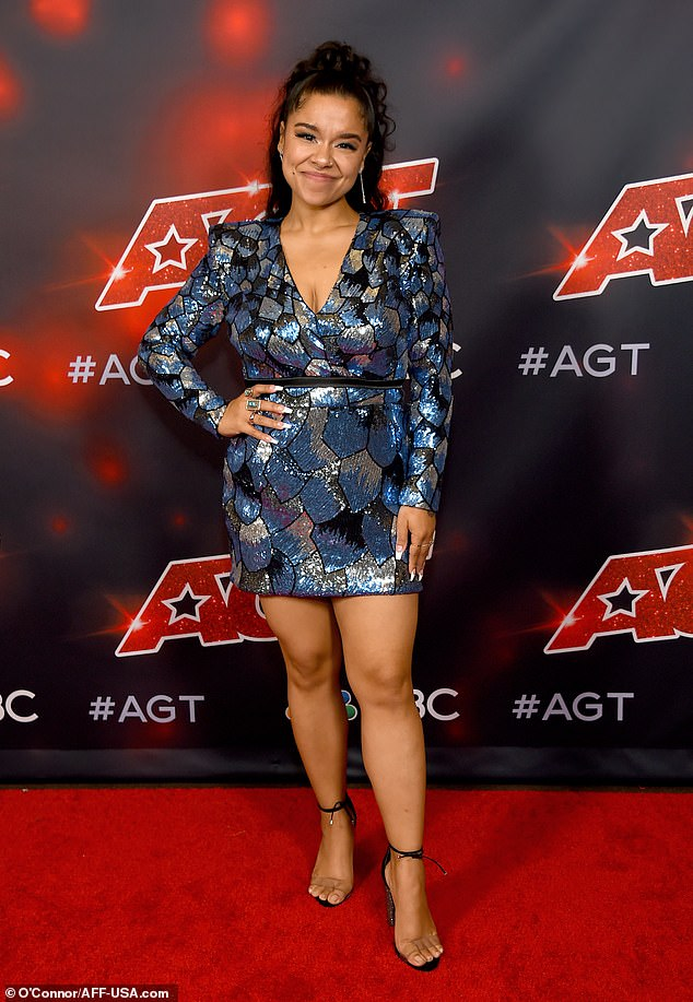 Glamour girl:Brooke Simpson, who impressed Heidi with her fashion sense, rocked a blue sequin mini dress and a pair of tie-wrap heels with a clear strap across the toes