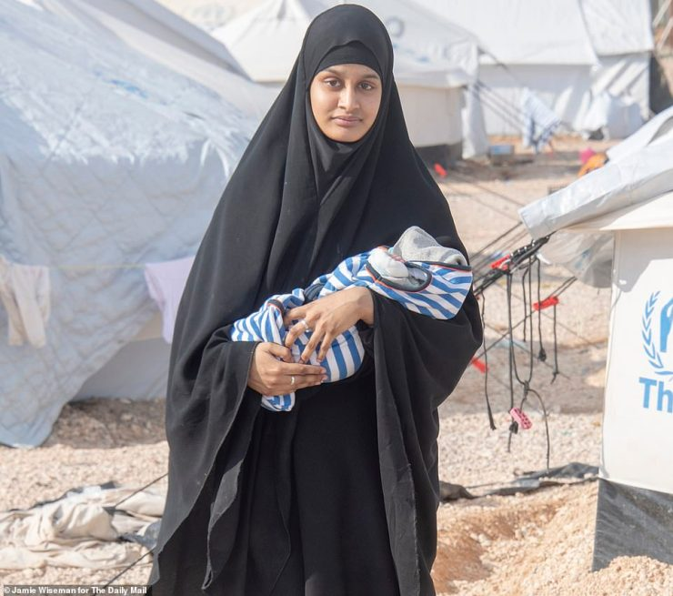 Begum now looks very different from her previous image as a jihadi bride in a hijab and head scarf. Pictured holding her baby in the Al Hawl camp, where the child died