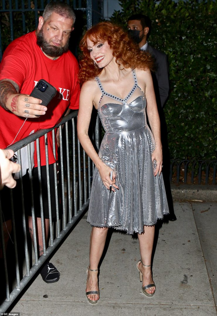 Fanfare: She later seen snapping selfies with fans eager to just catch a glimpse of the star