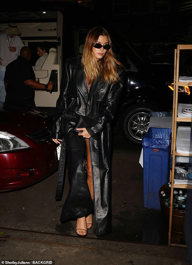 All in the details: Hailey accessorised her look with black sunglasses and wore her blonde locks in a centre parting