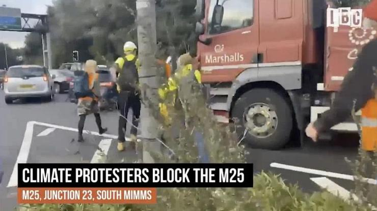Protesters held signs which said 'sorry for the disruption' as they clashed with drivers stuck in the queue. One motorist at the scene told LBC: 'They are working against themselves', while others screamed abuse telling the activists 'we'll lose our jobs'