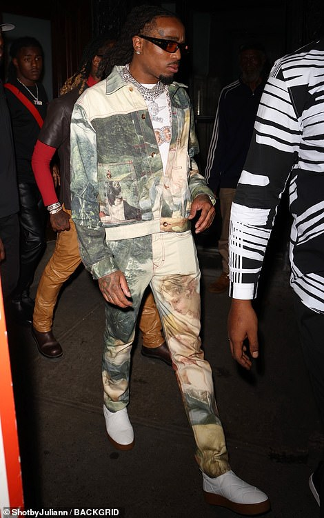 Stylish: His cousin Quavo wore an eye-catching co-ord as he left the party