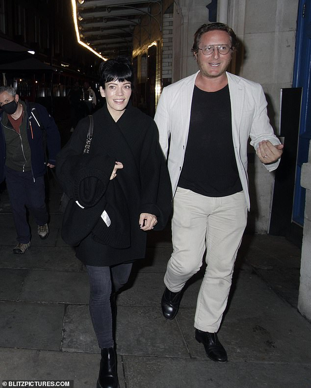 Cheerful: Lily Allen looked upbeat as she left London 's Noel Coward Theatre alongside a male companion on Tuesday after another performancein 2:22 A Ghost Story