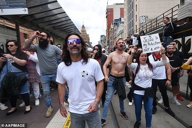 Buses, trams and trains will be stopped from entering the CBD in an effort to prevent unlawful access to Melbourne CBD (pictured, protesters storm Melbourne CBD in August)