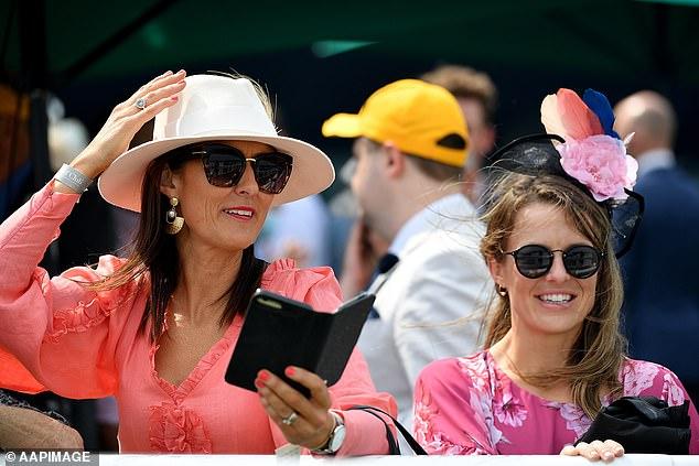 Punters watch in fascinators at Royal Randwick Racecourse in Sydney in 2020