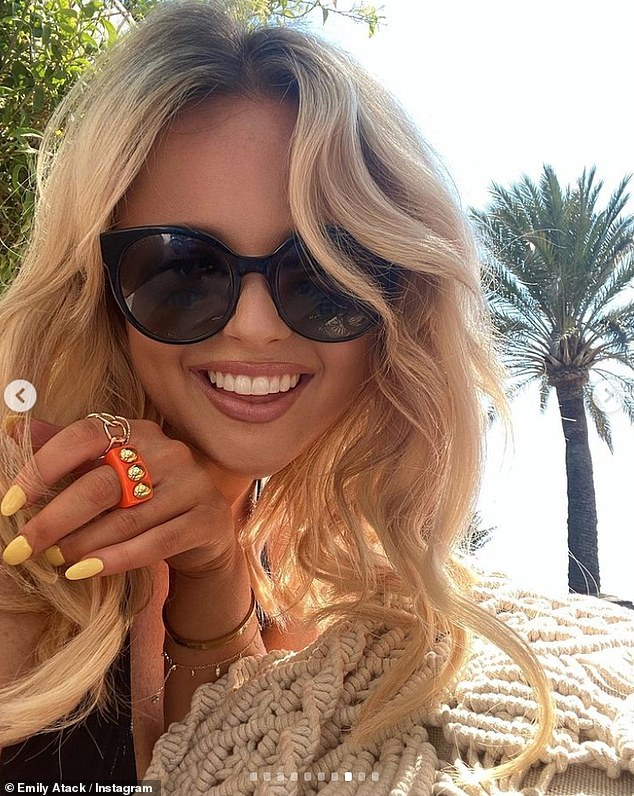 Loving life: The star beamed as she chilled out on a sun bed in glamorous black sunglasses