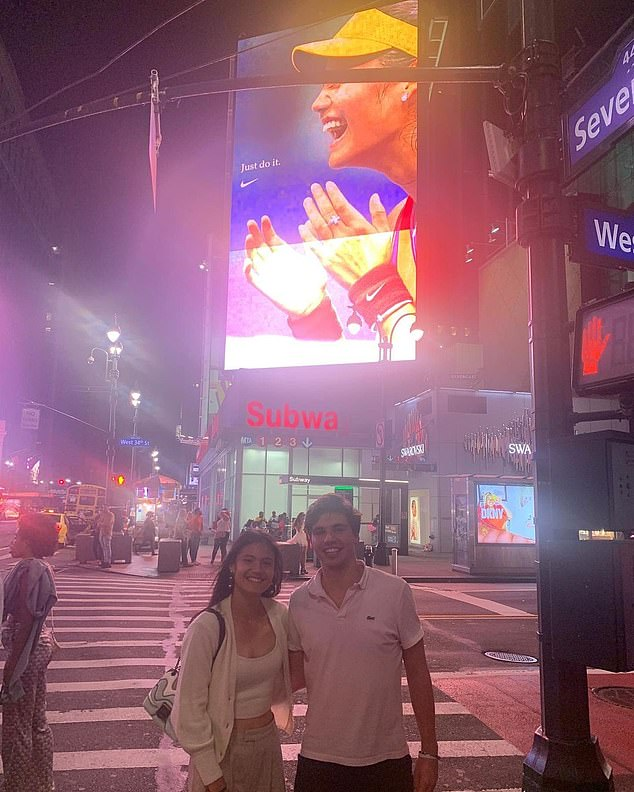 Following her victory at the Arthur Ashe Stadium on Saturday, Miss Raducanu, 18, posed with her old palBenjamin Heynold for a photo beneath a Manhattan billboard celebrating the city's new Grand Slam star