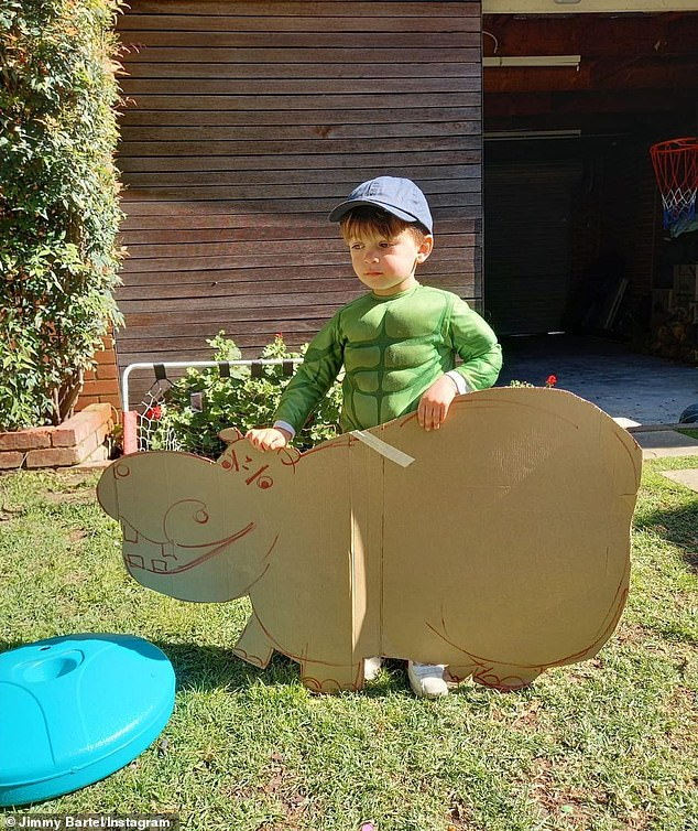 Play time: Henley donned an Incredible Hulk costume and was spotted carrying a cutout of a hippo