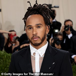Hamilton has since revealed that he will see a specialist ahead of the Russian GP as his neck is getting 'stiffer and tighter' - though that hasn't stopped him from attending New York's spectacular Met Gala last night (above).