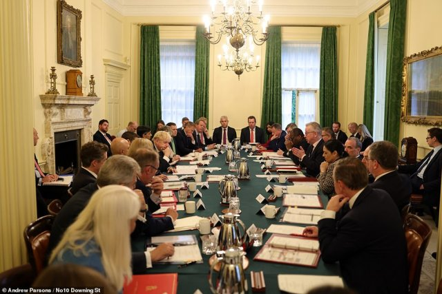 Mr Johnson holding a Cabinet meeting in Downing Street yesterday, as the government launches its Covid winter plan