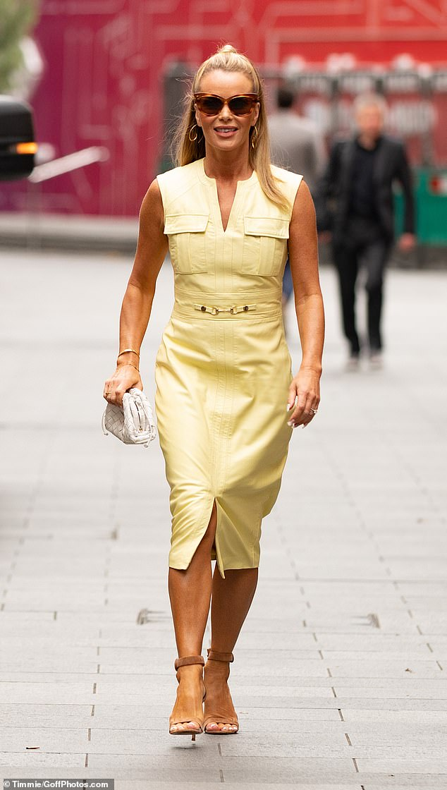 Flawless: Amanda completed her ensemble with a thin gold bangle and a pair of fashion forward swirl earrings as she walked confidently to her breakfast show