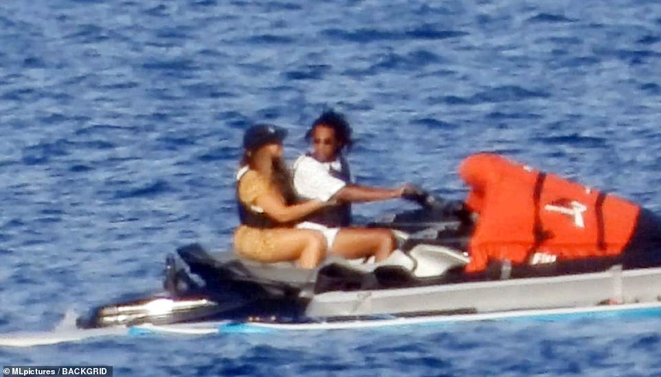 Here we go: Jay-Z watched his wife as they crossed the Mediterranean on Wednesday