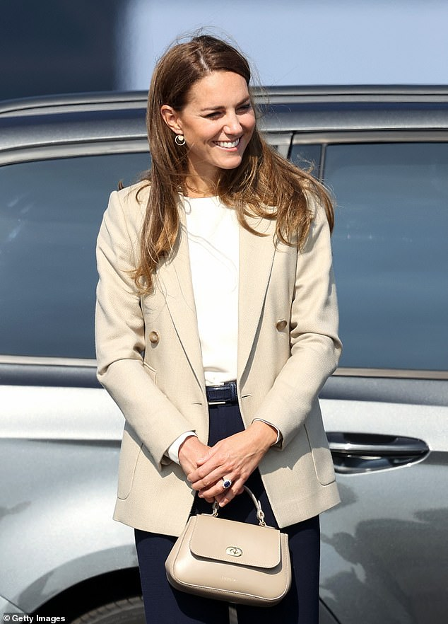 The Duchess of Cambridge (pictured), 39, put on an effortlessly stylish display as she arrived at RAF Brize Norton this afternoon to meet those who helped evacuate Afghans from their country last month