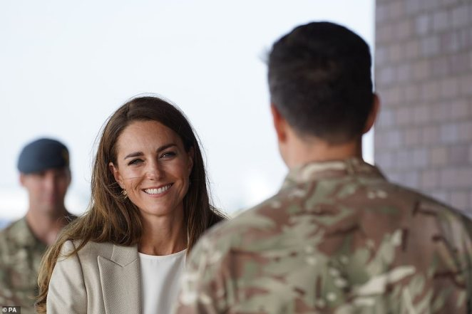 The Duchess of Cambridge speaks to a member of the armed forces during a visit to RAF Brize Norton this afternoon