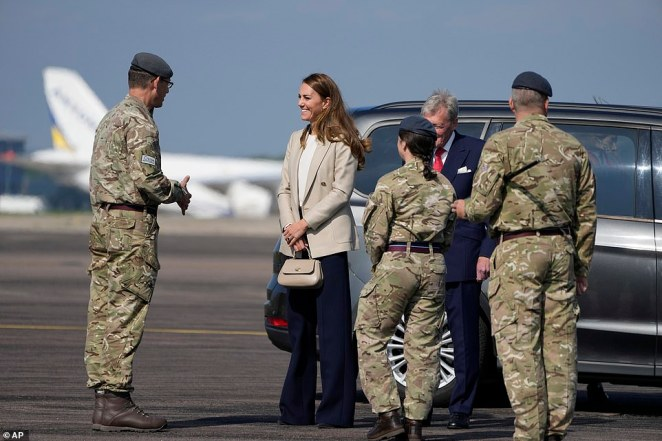The Duchess of Cambridge meets military personnel as she arrives for a visit to RAF Brize Norton this afternoon