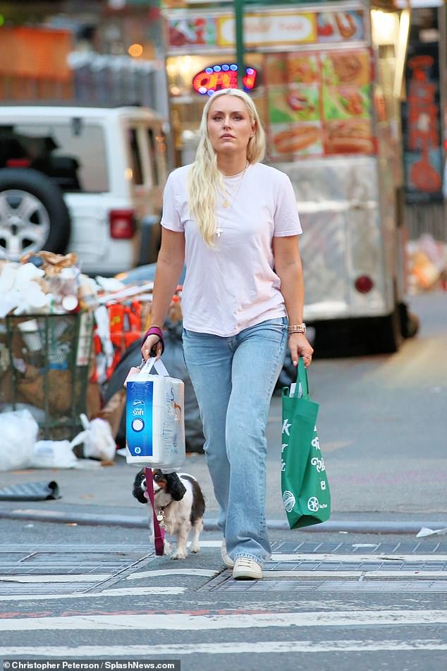 Errands: Three-time Olympic medalist Lindsey Vonn dressed down to shop at Duane Reade in Manhattan on Monday alongside her Cavalier King Charles Spaniel Lucy
