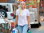 Lindsey Vonn dresses down to shop in NYC with her dogLucy... ahead ofESPN conference