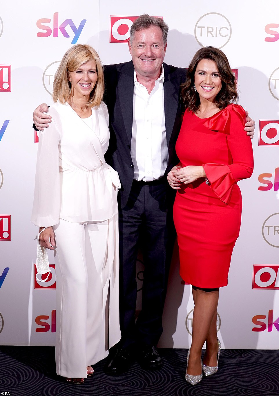 Colleagues: Piers threw his arms around the ladies, proving there was no grudge between the trio