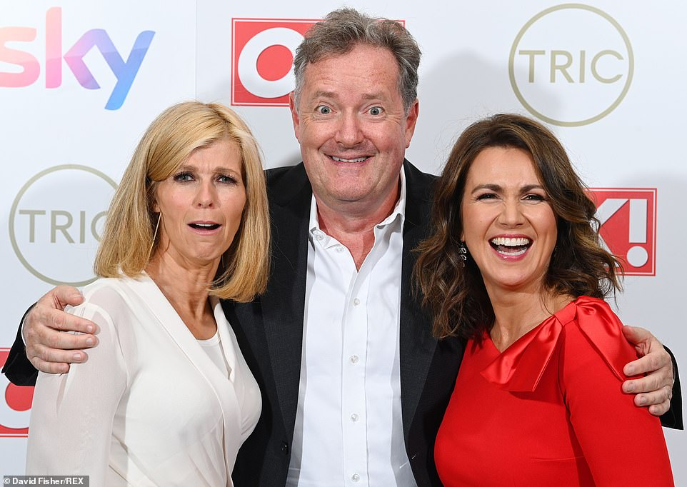 Happy!  The TV star, 56, looked delighted to be back with his former colleagues as he stood between them and posed for snaps