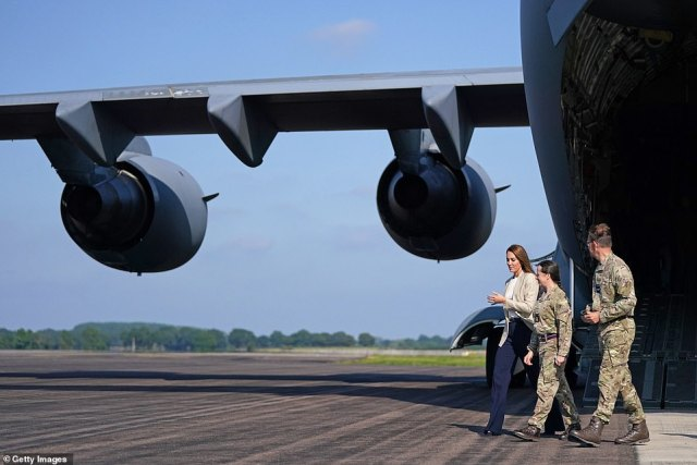 The Duchess of Cambridge walks from an RAF C17 Globemaster today to meet those who supported the Kabul evacuation