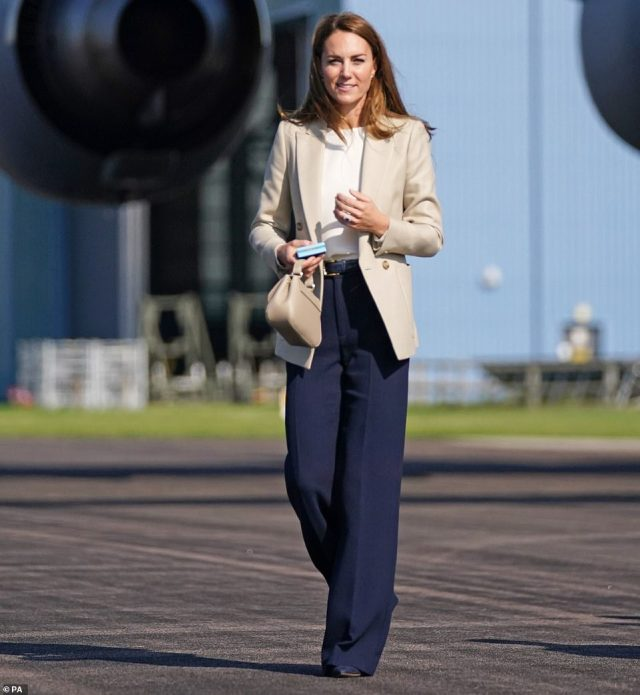 The Duchess of Cambridge walks from an RAF C17 Globemaster during a visit to RAF Brize Norton this afternoon