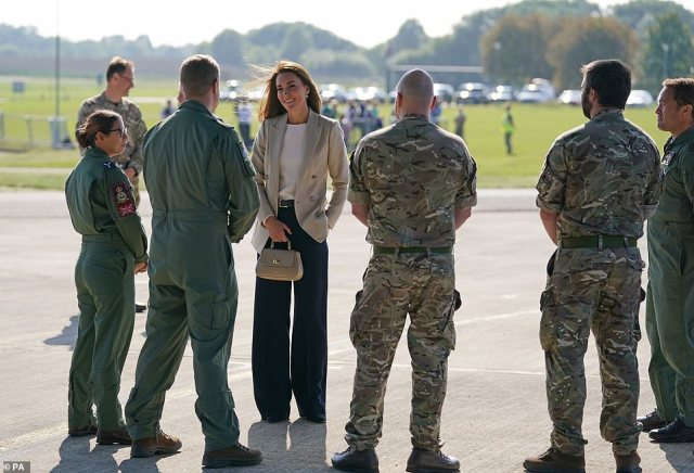 The Duchess of Cambridge speaks to members of the armed forces during a visit to RAF Brize Norton this afternoon