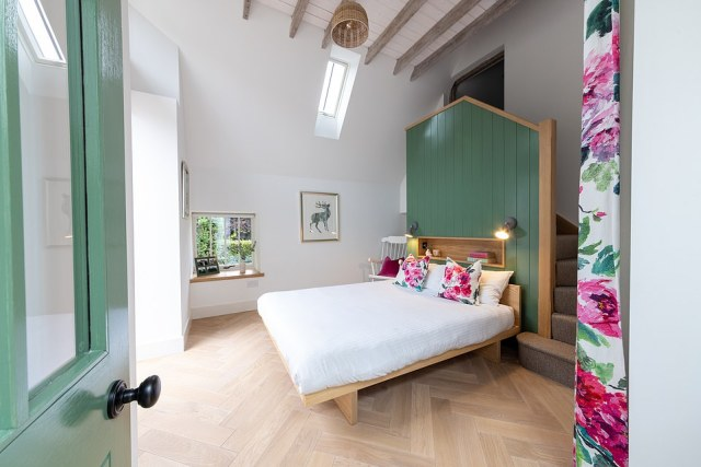 The couple, who had two young children, said they hoped to use the building's natural character to make a gorgeous forever home (pictured, the guest bedroom)
