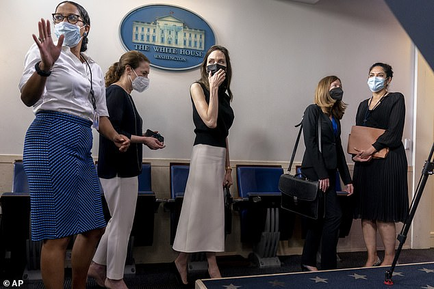 She took a few questions from reporters during her brief appearance.'I feel like I walked into a press conference,' she said, before saying she had had a good series of meetings