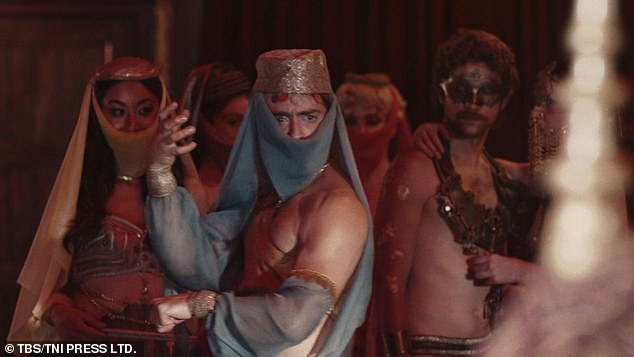 Performance: Daniel is surrounded by several other less dressed dancers for the scene as he appears to try and dance for an off-screen character