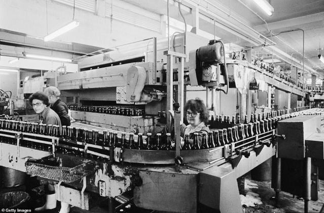Staff members at the bottling plant of Truman Brewery are seen hard at work in 1976.In 1989 the brewery and pubs were sold and Truman's closed its doors