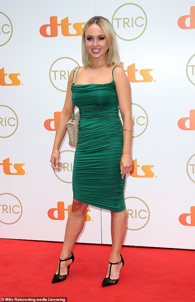 Stepping out: Jorgie Porter, 33, dazzled in an emerald green dress as she arrived on the red carpet at the TRIC Awards 2021 in London on Wednesday night