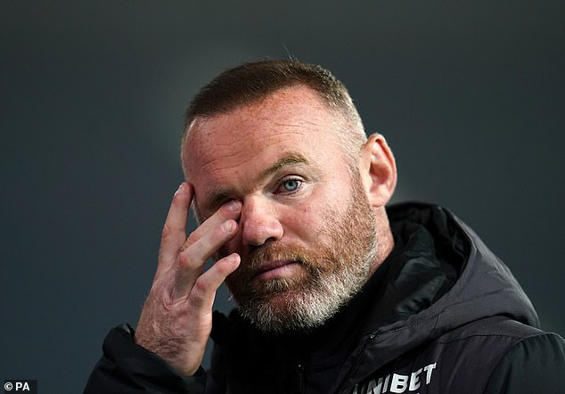 Derby County are set to be awarded a 12-point penalty, managed by Wayne Rooney (pictured)