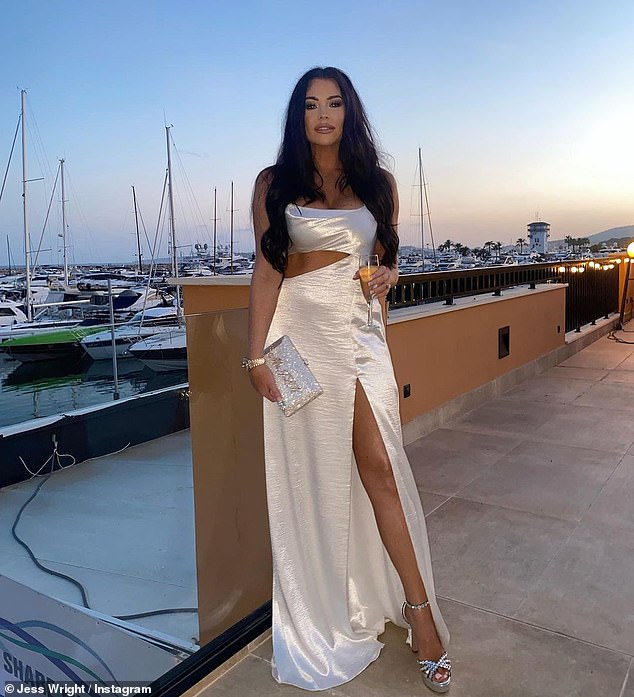 Vision in white:Also on Wednesday, Jess uploaded a photo from the night before her wedding as she looked incredible in a flowing white gown which revealed her toned midriff