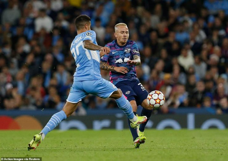Former Manchester CIty defender Angelino (right) earned a second yellow card and a red to quash Leipzig's resistance
