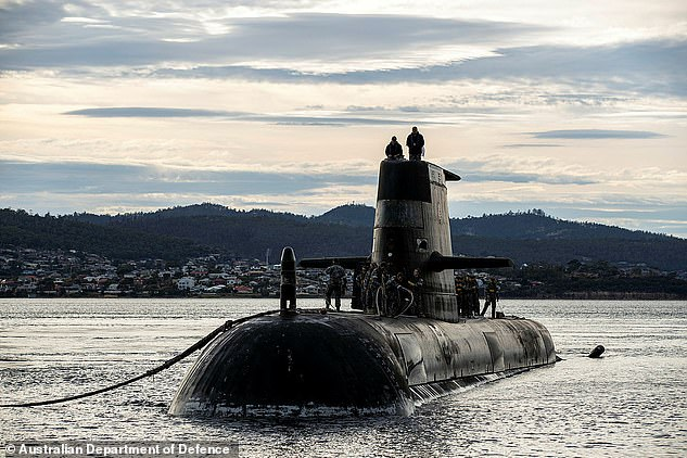 Pictured: The Sheean in Tasmania in April. The deal will mean Australia will walk away from its controversial deal to spend up to $90 billion buying French diesel-powered submarines