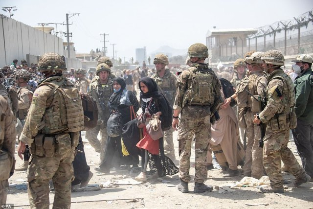 Members of the British and US military engaged in the evacuation of people out of Kabul, Afghanistan