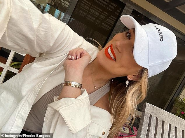 Merchandise: Phoebe also shared a gallery of photos of herself posing in a 'Vaxxed' cap