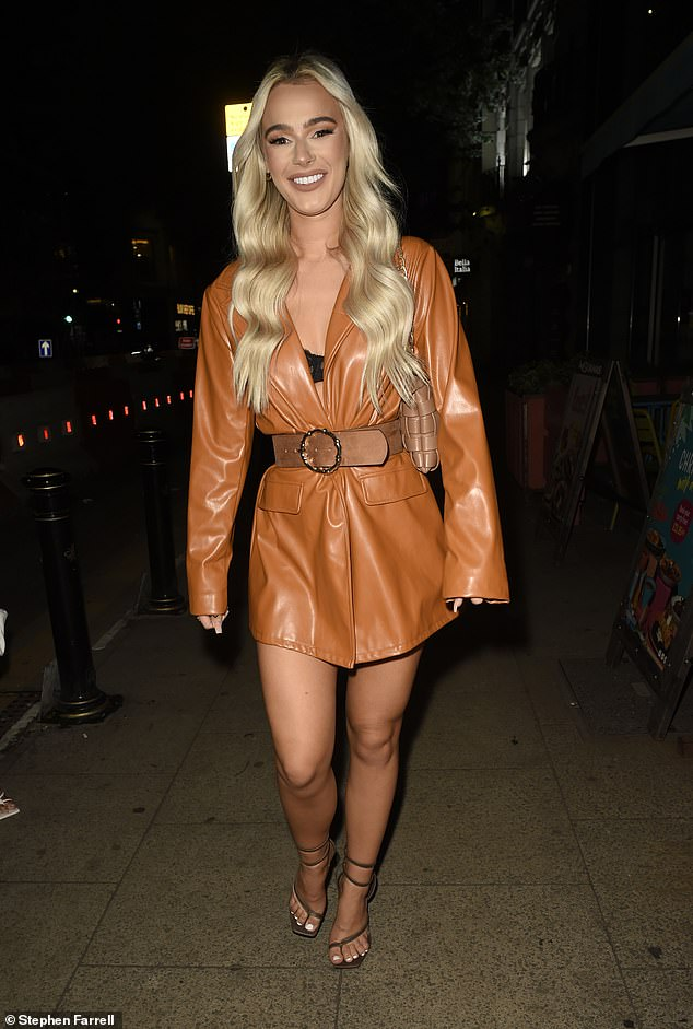 Dressing up:The Love Island star was seen teetering on a pair of skyscraper strappy stilettos as she headed to the venue