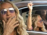 Carrie's smoking again! Sarah Jessica Parker puffs away on the NYC set of And Just Like That