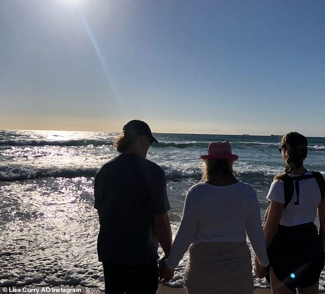 Loss:Lisa Curry (centre) and her family made a poignant trip to the beach this week, to commemorate one year since the devastating death of her daughter Jaimi. Pictured alongside her son Jett (left) and daughter Morgan (right)