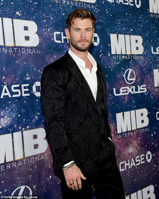 'Too troublesome': While filming is technically considered 'essential work' in Australia, many productions have struggled to navigate complicated health regulations and border closures. Pictured: Chris Hemsworth, whose filmExtraction 2 moved from Sydney toPrague last month