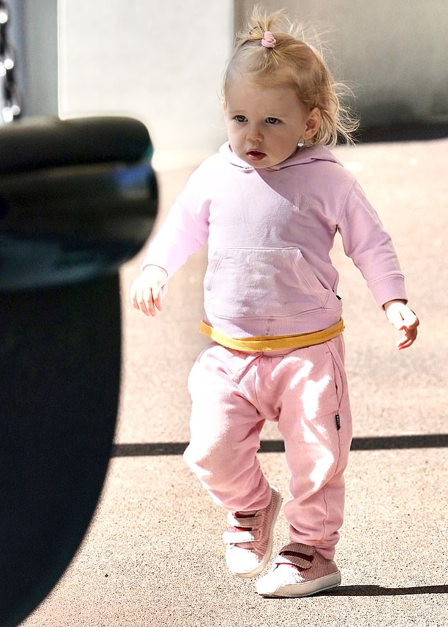 Play time in pink: Meanwhile, the youngest daughter of Karl Stefanovic was dressed in an all-pink tracksuit for her park visit