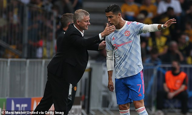 Ole Gunnar Solskjaer had been joined by Ronaldo in his technical area during the second half