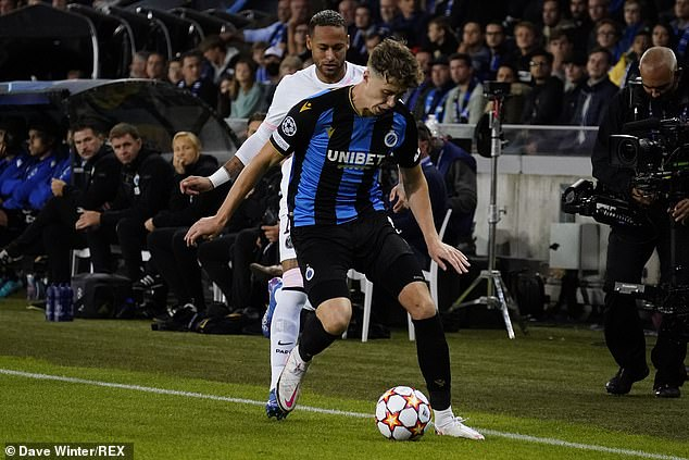Hendry holds off a challenge from Neymar as Club Bruges hold PSG to a 1-1 draw