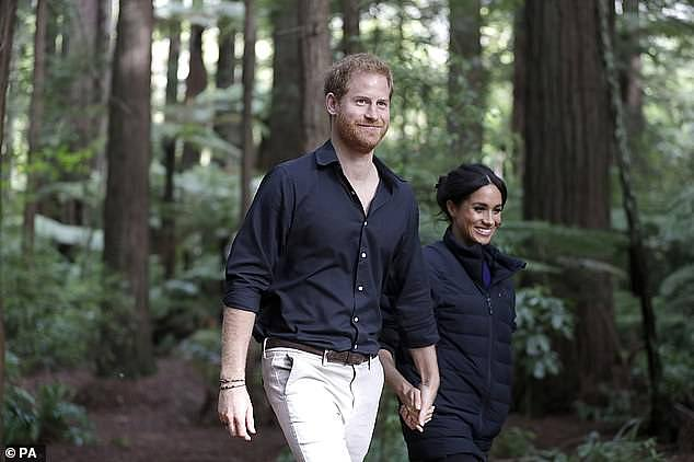 The 2018 picture, which came days after Meghan announced her pregnancy, the Duchess of Sussex dressed down in Prince Harry 's padded jacket and a favourite pair of jeans. She threw the £399 ($702 AUD) coat from Norwegian label Norrøna over a bespoke Givenchy jumper for the outing to Whakarewarewa Forest, near the city of Rotorua.