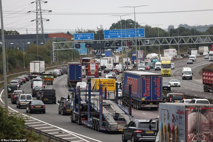 Queues of traffic on the M25 banking up to junction 22 caused by the climate change demos
